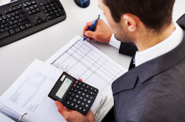 Man using a calculator to get an estimate